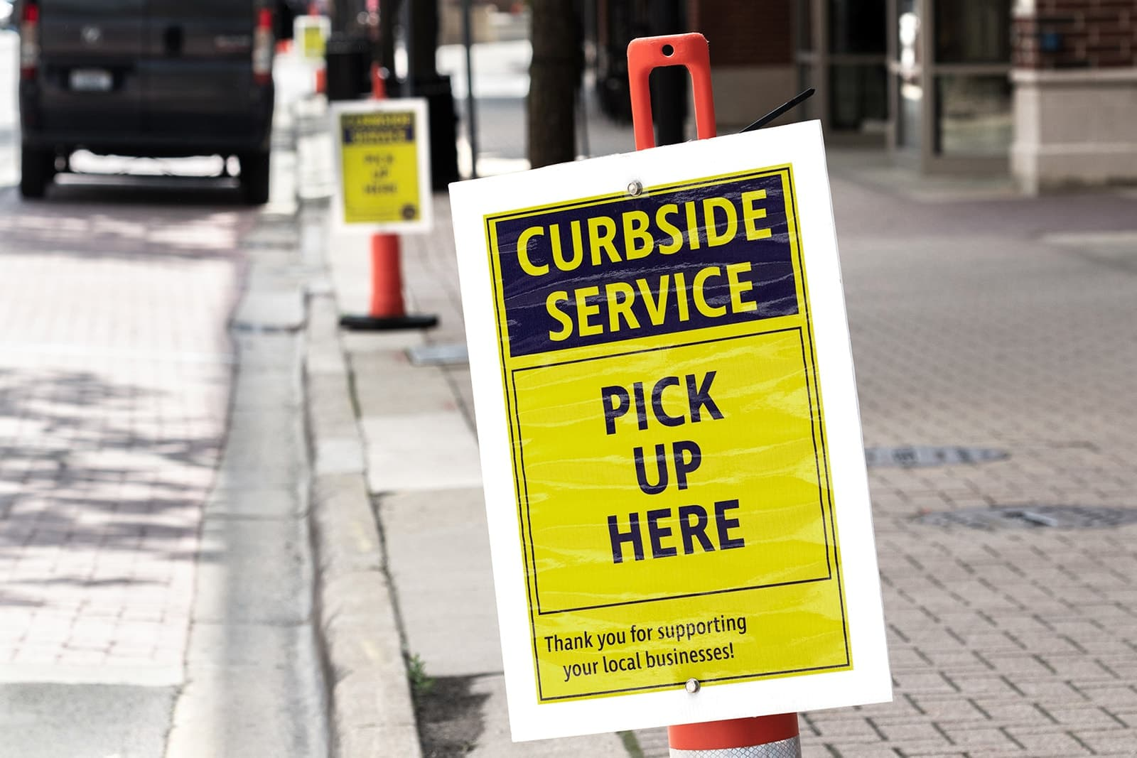Sign on the street indicating curbside service