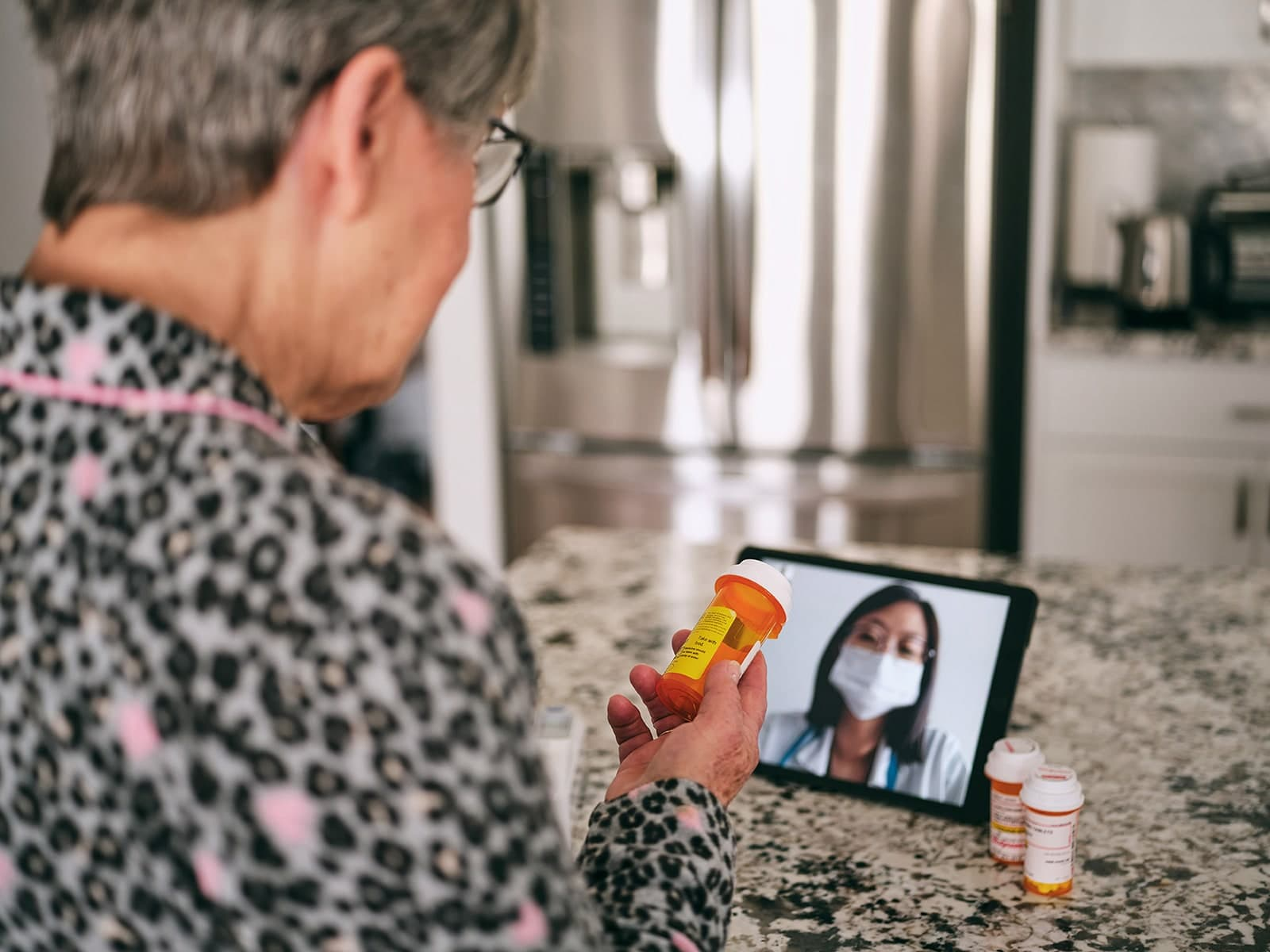 Patient chatting with her doctor via telehealth video